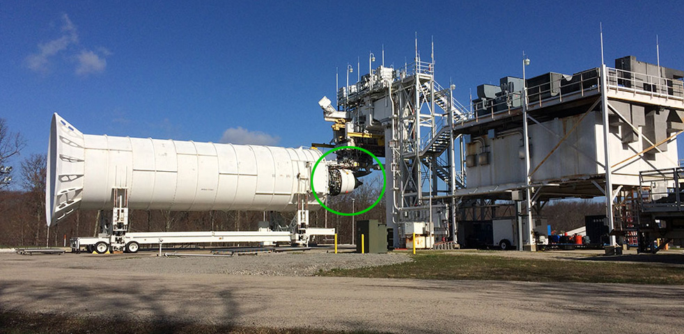 Nexcelle's O-Duct thrust reverser is visible on the LEAP-1C engine (circled, at center of the photo) during ground testing at Peebles, Ohio. Dominating this test installation is a re-ingestion tunnel, which prevents air emanating from the reverse thrust to re-enter the engine.