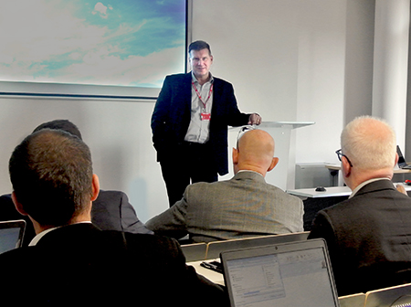 Nexcelle President Kenneth Onderko speaks at program review for management meeting in France